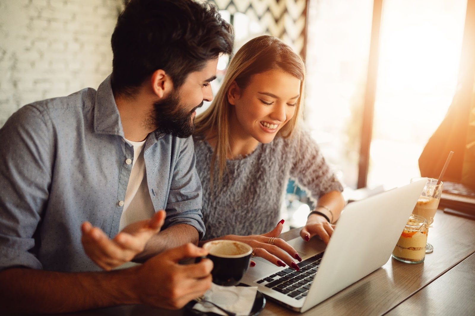 Couple looking at lending information on a laptop